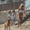 Pamela Anderson In Bikini Candids At Malibu Beach - Oct 13 2007