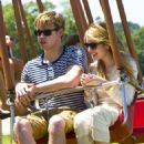 Emma Roberts and her boyfriend Chord Overstreet enjoy some fun in the sun at Super Saturday 14 to benefit Ovarian Cancer Research Fund held at Nova's Art Project on Saturday (July 30) in Water Mill, NY