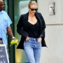Rosie Huntington Whiteley- Heads out of her hotel in New York