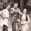Richard Todd, Walt Disney, Joan Rice during the filming of