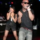 Teairra Mari and Pleasure P performing