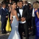 Ex-AC Milan player marries his model girlfriend in a lavish Sardinian ceremony with TWO wedding dresses, Tiffany rings and a surprise gig by Andrea Bocelli
