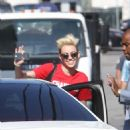 Miley Cyrus greets Pharrell Williams as she arrives at 'Jimmy Kimmel Live', an American late-night talk show for a taped appearance in Hollywood