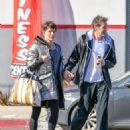 Milla Jovovich and Paul Anderson – Leaving the gym in Los Angeles - 454 x 568