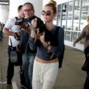 Mley Cyrus and Family With Puppy at the Airport