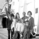July 29th, 1963 - The Rt Hon Sir David Ormsby-Gore KCMG went aboard the Queen Mary on her arrival today at Southhampton with his children Julian (22, dark glasses), Jane (20) and Victoria (16) to meet his wife Lady Ormsby-Gore, daughter Alice (11, with co - 454 x 409