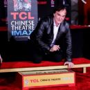 Quentin Tarantino immortalized in cement at TCL Chinese Theatre - 454 x 430