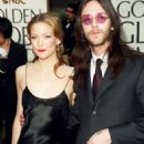 Kate Hudson and Chris Robinson attends the 58th Annual Golden Globe Awards (January 21, 2001)