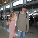 Paris Hilton and Chris Zylka at LAX Airport in Los Angeles - 454 x 580