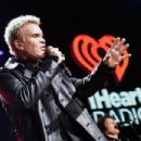 Recording artist Billy Idol performs onstage during the first ever iHeart80s Party at The Forum on February 20, 2016 in Inglewood, California. - 454 x 302