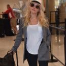 Katheryn Winnick at LMM airport in San Juan - 454 x 777