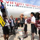 Amber Rose attends the Launch of Virgin America's First Flight from Los Angeles to Philadelphia at Los Angeles International Airport in Los Angeles, California - April 4, 2012 - 454 x 576