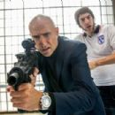 Sacha Baron Cohen and Mark Strong in 'The Brothers Grimsby' - 454 x 303