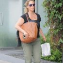 Elizabeth Berkley stops by a salon in West Hollywood, California on April 6, 2016 - 403 x 600