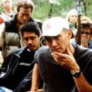 Producer Dean Devlin (left foreground) and director/executive producer Roland Emmerich watch a scene play out during the South Carolina-based filming of the Columbia Pictures presentation, The Patriot - 2000 - 267 x 400