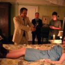 Nell Sweetzer (Ashley Bell, front), Cotton Marcus (Patrick Fabian, left), Louis Sweetzer (Louis Herthum, center), and Caleb Sweetzer (Caleb Landry Jones, right) in THE LAST EXORCISM. Photo credit: Patti Perret - 454 x 303