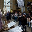 Director DAVID YATES (far right) and the crew watch MICHAEL GAMBON as Albus Dumbledore film a scene from Warner Bros. Pictures' fantasy 'Harry Potter and The Half-Blood Prince.' Photo by Jaap Buitendijk