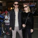 Brie LarsonandAlex Greenwald at LAX Airport in Los Angeles - 454 x 721