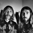 Duane Allman with Gregg Allman and Berry Oakley backstage before the Allman Brothers' performance at the Sitar on October 17, 1970 in Spartanburg, South Carolina - 454 x 359