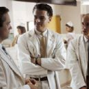 Frank Abagnale (Leonardo DiCaprio) poses as a doctor and intimidates two residents, Dr. Ashland (Johnathan Brent) and Dr. Harris (Shane Edelman),in Dreamworks' Catch Me If You Can - 2002 - 454 x 301