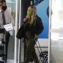 Natalie Alyn Lind – Wearing mask while arriving in Vancouver - 454 x 568
