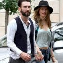 Adam Levine holds hands with his fiancee Behati Prinsloo on Sunday in New York City. (July 28)