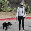 Miley Cyrus takes her beloved dog Mary Jane on a hike in Beverly Hills, California on January 12, 2014
