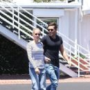 Newly engaged couple Claire Holt and Matt Kaplan are spotted leaving Fred Segal in West Hollywood, California on July 14, 2015
