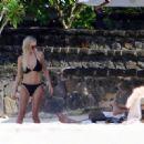 Una Healy in Black Bikini in Mauritius
