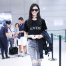 Ming Xi – Arrives at Airport in Shanghai - 454 x 681