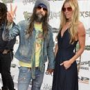 Rob Zombie and Sheri Moon Zombie attend the 2015 Journeys AP Music Awards, Fueled by Monster Energy Drink at Quicken Loans Arena on July 22, 2015 in Cleveland, Ohio. - 358 x 600