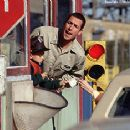 Adam Sandler and Cole and Dylan Sprouse work the tollbooth in Big Daddy