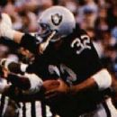 Marcus Allen rushes in Super Bowl XVIII
