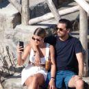 Sofia Richie in White Mini Skirt on vacation in Nerano