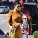 Tyga arrives at Smashbox Studios in Culver City with his girl toy September 29, 2015