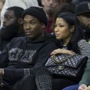 Meek Mill and Nicki Minaj watch the game between the Golden State Warriors and Philadelphia 76ers on January 30, 2016 at the Wells Fargo Center in Philadelphia, Pennsylvania - 454 x 381