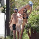 PICTURE EXCLUSIVE Irina Shayk displays her slender supermodel body in a black string bikini as she enjoys swim with shirtless hunky beau Bradley Cooper during romantic Lake Garda getaway - 454 x 546