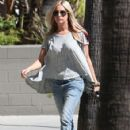 Ashley Tisdale chatting on her phone while running some errands in Hollywood, CA on March 3, 2012