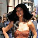 Nicole Scherzinger poses outside her hotel