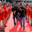 (L-R) Giedo van der Garde of the Netherlands and Caterham and Kimi Raikkonen of Finland and Lotus attend the drivers parade before the British Formula One Grand Prix at Silverstone Circuit on June 30, 2013 in Northampton, England