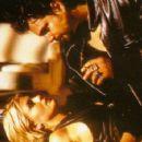 Nicole Eggert as Alyssa Lloyd in  The Demolitionist (1995)