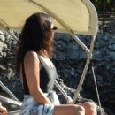 Kourtney Kardashian in Black Swimsuit on a boat in Portofino