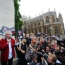 Brian May leads an anti-fox hunting rally for PETA on July 14, 2015 in London, England. - 454 x 289