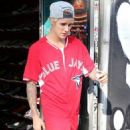 Justin Bieber stop to grab some lunch at Earth Cafe in West Hollywood, California after shopping for sneakers at Sportie LA on January 21, 2015
