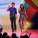 Chris Colfer (L) and Victoria Justice speak onstage during the 2012 Teen Choice Awards at Gibson Amphitheatre on July 22, 2012 in Universal City, California - 454 x 346