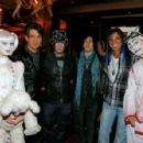 "(2nd L-R) Illusionist Criss Angel, guitarists DJ Ashba and Richard Fortus of Guns N' Roses and artist Michael Godard appear with ""Zarkana by Cirque du Soleil"" characters at the reception for the Las Vegas premiere of ""Zarkana by Cirque du Soleil"" at the G"