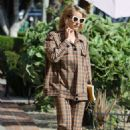 Emma Roberts – Leaving a salon in Los Angeles