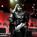 Musician Gene Simmons of KISS performs onstage during the 23rd Annual Race To Erase MS Gala at The Beverly Hilton Hotel on April 15, 2016 in Beverly Hills, California - 397 x 600