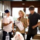 Director Robert Luketic (left) with Katherine Heigl (as Jen, center) and Ashton Kutcher (as Spencer, right) on the set of KILLERS. Photo credit: Melissa Moseley