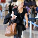 Malin Akerman departing on a flight at LAX airport in Los Angeles, California on January 26, 2015